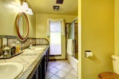 Elegant bathroom with stone wall trim Stock Photo