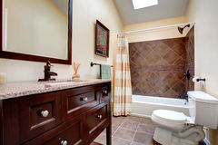 Elegant bathroom with tile wall trim Royalty Free Stock Images