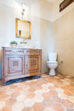 Elegant bathroom with toilet and cabinet Royalty Free Stock Images