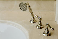 Elegant bathtub faucet Stock Images