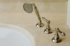 Elegant bathtub faucet. With back splash Stock Images