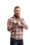 Elegant bearded man holding smoking pipe. Portrait of handsome bearded man in checked shirt smoking pipe. Studio shot. Isolated Stock Images