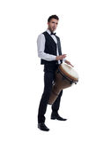 Elegant bearded man plays on percussion Stock Photography