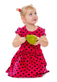 Elegant beautiful blonde girl with pear in hand Stock Image