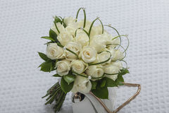 Elegant beautiful bridal bouquet of white roses with pearls Stock Photos