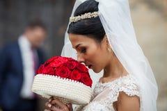 Elegant beautiful brunette bride walking down old european stree Royalty Free Stock Images
