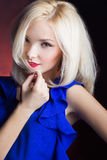 Elegant beautiful girl blonde with red lips in a blue dress in the Studio Royalty Free Stock Images