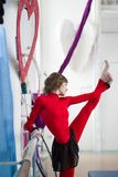 Elegant gymnast doing stretching with barre in a studio. Elegant beautiful gymnast doing stretching twine exercise with barre in a studio Stock Photography