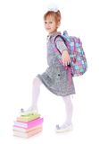 Elegant beautiful schoolgirl with satchel on his Royalty Free Stock Image