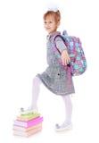 Elegant beautiful schoolgirl with satchel on his Royalty Free Stock Image