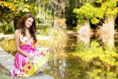 Elegant beautiful woman with colorful dress. Outdoor stock photography