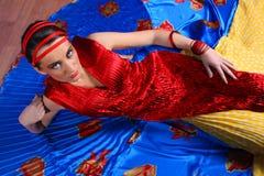 Elegant beautiful woman in colourful dress Royalty Free Stock Photos