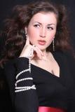 Elegant and beautiful woman in jewelry. Elegant and beautiful young woman in jewelry Royalty Free Stock Photo