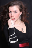 Elegant and beautiful woman in jewelry. Elegant and beautiful young woman in jewelry Stock Photo