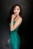 Elegant beautiful woman posing in studio. Royalty Free Stock Images