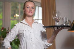Elegant beautiful woman serving drinks Royalty Free Stock Photo