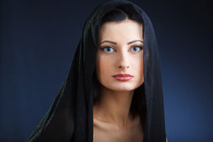 Elegant beautiful woman in shawl Royalty Free Stock Images