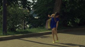 Elegant woman twisting her ankle while walking on street stock footage