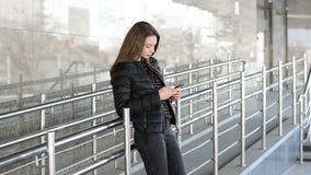 Elegant beautiful woman texting on smartphone in the city. Elegant beautiful woman texting on smartphone stock video footage