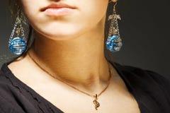 Elegant beautiful woman wearing jewelry. Portrait of elegant beautiful woman wearing jewelry stock photography