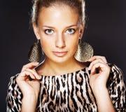 Elegant beautiful woman wearing jewelry. Portrait of elegant beautiful woman wearing jewelry royalty free stock image