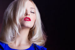 Elegant beautiful women blonde with red lips in a blue dress in the Studio Royalty Free Stock Images