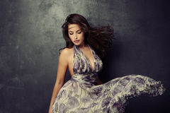 Elegant beauty. Beautiful young  woman in an elegant dress studio shot Stock Photos