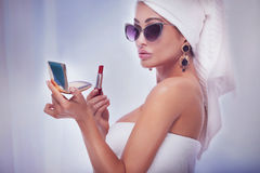 Elegant beauty doing makeup. Beautiful elegant lady posing in bathroom, doing makeup. Luxury concept Stock Photography