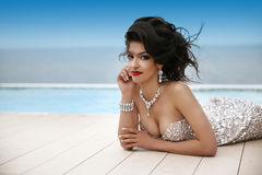 Elegant beauty fashion brunette in luxury dress with diamond jew Royalty Free Stock Photo