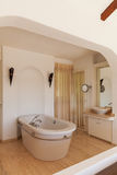 Elegant bedroom with bath tube Stock Photography