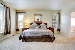 Elegant bedroom with beautiful bedding. Elegant master bedroom with rich furniture set and beautiful bedding Royalty Free Stock Photos