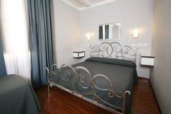 Elegant bedroom. Contemporary elegant home furnished bedroom interior Royalty Free Stock Image