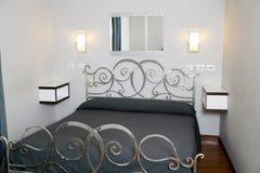 Elegant bedroom. Contemporary elegant home furnished bedroom interior Stock Photography