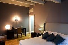 Elegant bedroom. Contemporary elegant home furnished bedroom interior Stock Photo