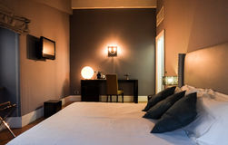 Elegant bedroom. Contemporary elegant home furnished bedroom interior Royalty Free Stock Photography