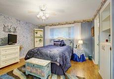 Elegant bedroom with hardwood floors. Royalty Free Stock Images