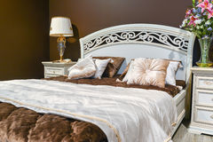 Elegant bedroom interior with  large bed Royalty Free Stock Photography