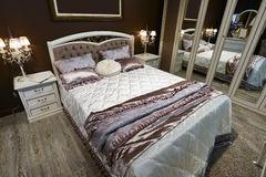 Elegant bedroom interior with  large bed Stock Images