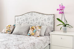 Elegant bedroom in soft light colors. Big bed at center Stock Photos