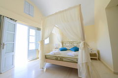Elegant bedroom with a tent bed in beige stock photo