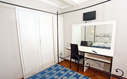 Elegant bedroom. View of bedroom with window, desk, mirror and TV in an elegant hotel in Rome Stock Photography