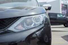 Elegant black car headlight outdoors Stock Images