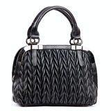 Elegant black female bag. Over white background Royalty Free Stock Photo