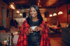 Elegant black girl in a cafe stock image