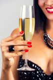 Elegant black hair woman drinking champagne. Stock Image