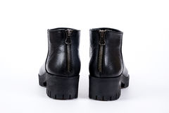 Elegant black ladies` boots on a white background Stock Images