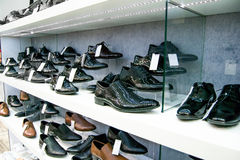 Elegant black leather man type of shoes selected and placed in order according to the latest fashion trends Stock Photography