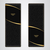 Elegant black leather vertical banner with two gold stripes. Royalty Free Stock Image