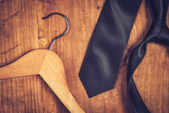 Elegant black tie and cloth hanger Royalty Free Stock Photo