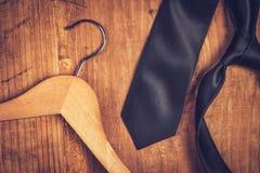 Elegant black tie and cloth hanger Royalty Free Stock Photo